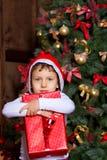 Flicka med gåvor royaltyfria foton