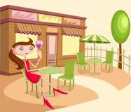 Flicka med glass sammanträde för drink i stol Arkivbilder