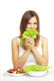 Flicka med grönsaksallad Fotografering för Bildbyråer