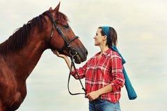 Flicka med hästen Royaltyfria Foton