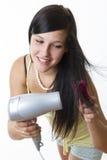 Flicka med hårtork Royaltyfri Bild