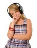 Flicka med hörlurar Arkivfoto