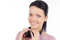 Flicka med hörlurar. Arkivfoto