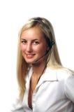 Flicka med hörlurar med mikrofon Royaltyfri Foto