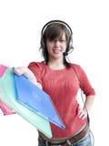 Flicka med hörlurar och CD royaltyfri foto