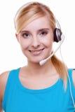 Flicka med hörlurar och mikrofonhörlurar med mikrofon Fotografering för Bildbyråer