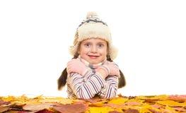 Flicka med höstsidor på vit Royaltyfria Bilder