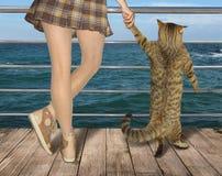 Flicka med hennes katt 1 arkivbild