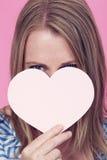 Flicka med hjärta Arkivbild