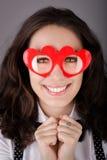 Flicka med Hjärta-formade exponeringsglas Royaltyfri Foto