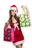 Flicka med jul som shoppar i hatten av Santa Claus Arkivbilder