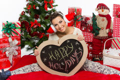Flicka med jultillbehör arkivbilder