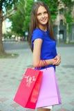 Flicka med köp Royaltyfri Bild