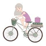 Flicka med katten på cykeln Arkivfoto