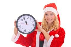Flicka med klockan för santa hattholding Arkivfoton