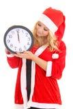 Flicka med klockan för santa hattholding Royaltyfria Foton