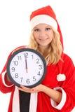 Flicka med klockan för santa hattholding Royaltyfri Fotografi