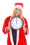 Flicka med klockan för santa hattholding Royaltyfria Bilder