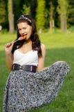 Flicka med klubban Royaltyfri Fotografi