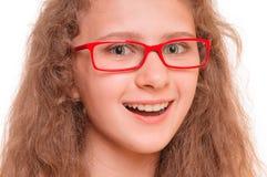 Flicka med läs- exponeringsglas Royaltyfri Bild