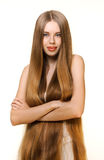 Flicka med långt blont hår royaltyfri fotografi