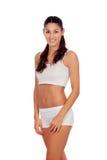 Flicka med långt hår i den vita underkläderna Arkivfoto