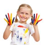 Flicka med målade händer Fotografering för Bildbyråer