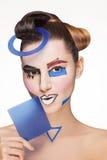 Flicka med målade matematiska diagram Fotografering för Bildbyråer