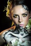 Flicka med makeup för allhelgonaafton skrämsel Royaltyfri Bild