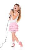 Flicka med mikrofonen Arkivbilder