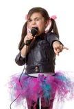 Flicka med mikrofonen Fotografering för Bildbyråer