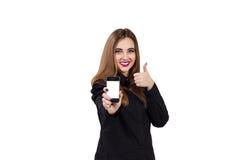 Flicka med mobiltelefonen i hand kvinna för white för affärspennstil Arkivbild