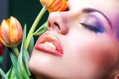 Flicka med orange kanter Arkivbild