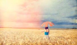Flicka med paraplyet Arkivfoto