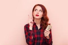 Flicka med pengar Arkivfoto