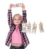 Flicka med pengar Arkivbilder