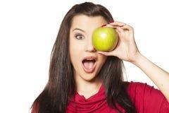 Flicka med äpplet Arkivbild