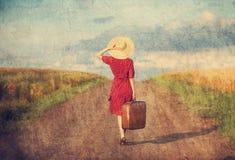 Flicka med resväskan Royaltyfri Bild