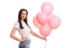 Flicka med rosa ballonger royaltyfria foton