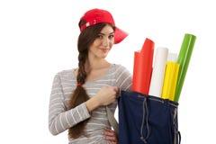 Flicka med rulle av papper Arkivbild