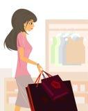 Flicka med shopping 免版税图库摄影