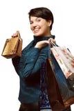 Flicka med shopping i påsar, Shopaholic, packar med saker Arkivfoto