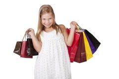 Flicka med shoppingpåsar Royaltyfri Bild