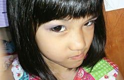 Flicka med självbelåten blick Fotografering för Bildbyråer