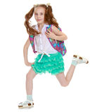 Flicka med skolaportföljen Royaltyfri Fotografi