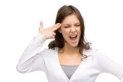 Flicka med stängt göra en gest för ögonhandvapen Fotografering för Bildbyråer