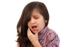 Flicka med tandvärk Fotografering för Bildbyråer