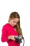 Flicka med tappningkameran som isoleras på vit bakgrund Fotografering för Bildbyråer