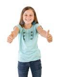 Flicka med tum upp Arkivfoto