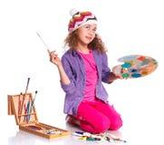 Flicka med vattenfärgmålning Arkivbilder